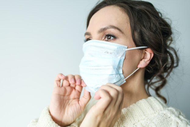 Women in white face mask